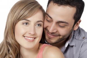 Close up image of beautiful romantic couple against white background